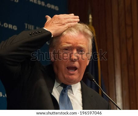 WASHINGTON MAY 27 2014 Real estate mogul Donald Trump demonstrates that the hair on his head really is his at a National Press Club luncheon