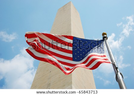 Washington Monument and national flag of USA