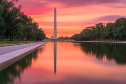 Washington Monument on the Reflecting Pool in Washington, DC at dawn.