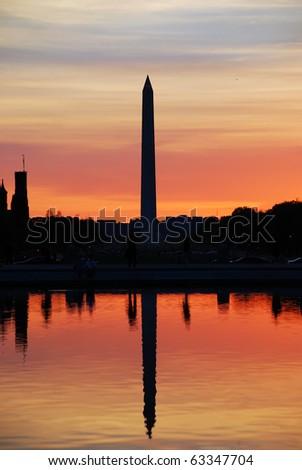 Washington monument sunset silhouette with lake reflection, Washington DC