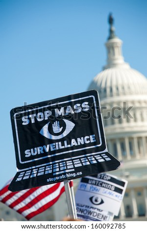 WASHINGTON - OCTOBER 26: Signs displayed during a rally against mass surveillance organized by the group Stop Watching Us in Washington, DC on October 26, 2013.