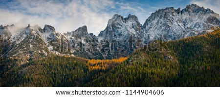 Washington Pass Along the North Cascades Highway During the Autumn Season. Larch trees and snow on the hills signal the approach of winter in the North Cascade Mountain range.