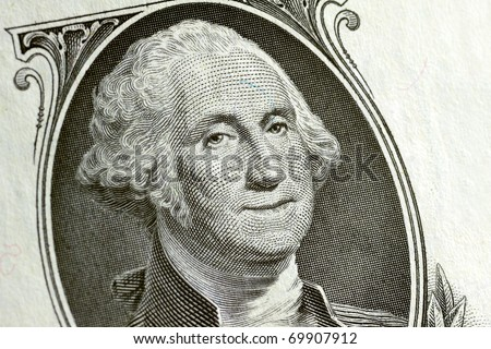 Washington smiling on a 1 dollar bill