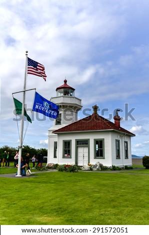 WASHINGTON, WA - APR 12, 2015 - Mukilteo Lighthouse at Mukilteo, Washington State, USA. It\'s a State Coastal Lighthouse (nautical beacon), has built in 1906.