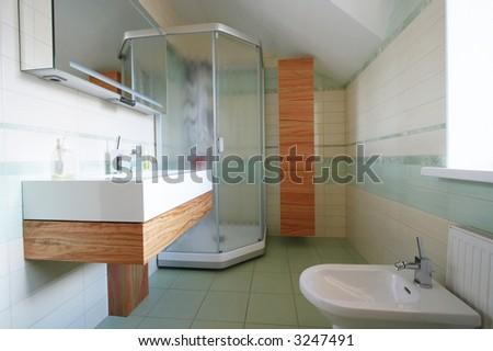 Washstand and bidet in a modern bathroom - stock photo
