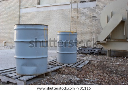 Waste barrels in an alley - stock photo