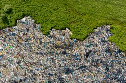 Waste garbage dump household pile trash, aerial top view background. Concept environmental struggle with plastic industry.