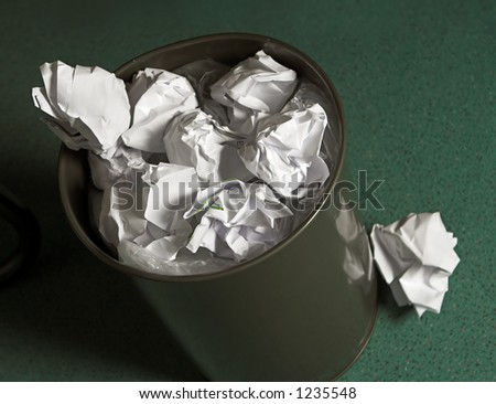 Waste paper basket, full of paper balls