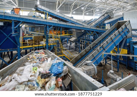 Waste sorting plant. Many different conveyors and bins. conveyors filled with various household waste. Foto d'archivio ©
