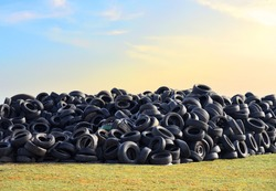 Waste tires and tyres at landfill for recycling. Regenerated tire rubber produced. Reuse of the waste rubber tyres. Pile of old wheels for recycling. Disposal of waste tires. Tyre dump