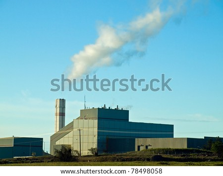 Waste to Energy Plant with Smoke Coming Out of a Smokestack