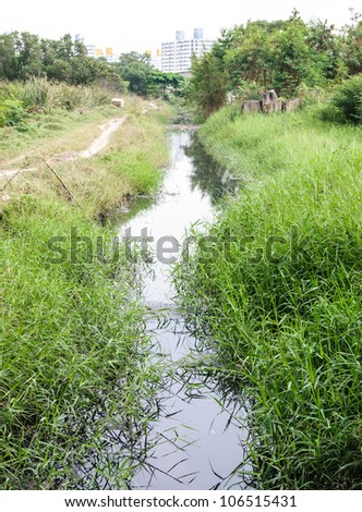 Waste water in canal from the urban building. - stock photo