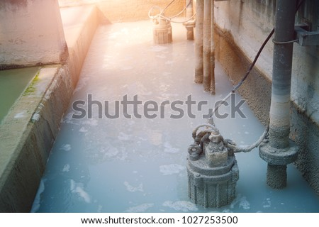 Waste water treatment pit with submersible pump - Shutterstock ID 1027253500