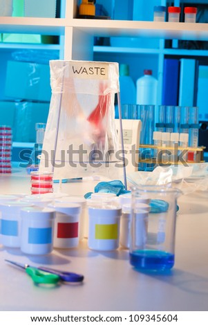 Wastebasket in the biochemical laboratory - stock photo