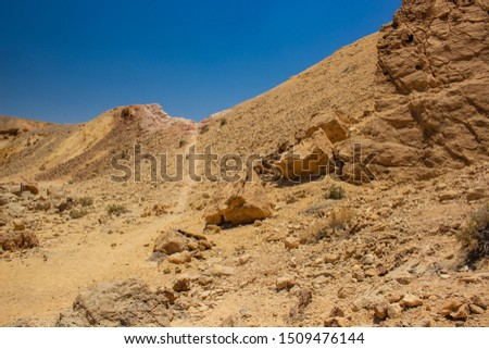 wasteland desert highland nature scenery landscape view with sand stone rocky hills and lonely narrow ground trail for some for some lost vagabond in this dangerous environment