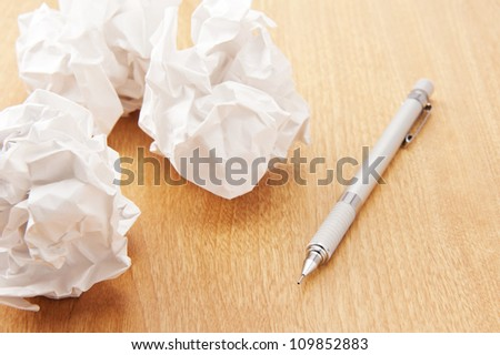 Wastepaper and pen on the table