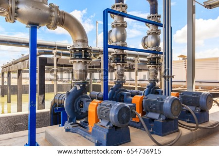 Photo of  Wastewater treatment plant. A new pumping station. Valves and pipes. Urban modern treatment facilities, pipelines and pumps powerful, modern automatic system protection and control.
