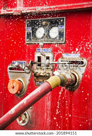 wasting water - water leaking from a connector of hose from fire truck