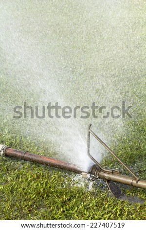 wasting water - water leaking from a connector of sprinkler pipe