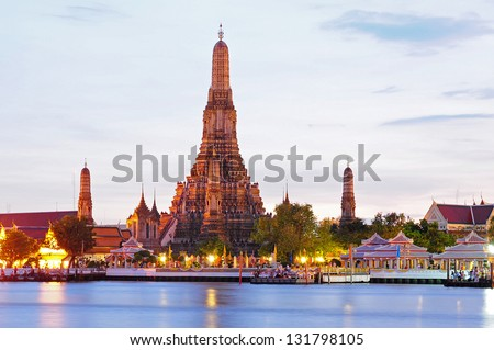 Wat Arun across Chao Phraya River during sunset in Bangkok, Thailand