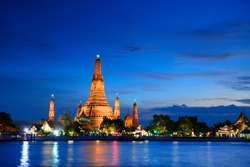 Wat Arun is a very beautiful Buddhism architecture pagoda at night skyline in Bangkok, Thailand