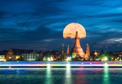 Wat Arun or Temple of Dawn is the most famous landmark of Bangkok, Thailand. it is also printed on 10 baht coin. The temple is shining with giant moon of supermoon phenomenon behind.