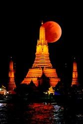 Wat Arun Temple and big moon at night in bangkok, thailand