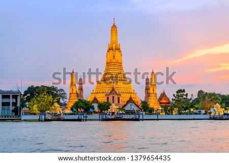 Wat Arun Temple at sunset in bangkok Thailand. Wat Arun is a Buddhist temple in Bangkok Yai district of Bangkok, Thailand,