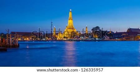 Wat Arun temple in sunset, Bangkok,Thailand Panorama - stock photo