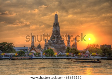 Wat Arun Thailand Temple in Sunset scene - stock photo