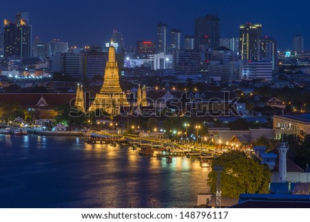 Wat Arun, The Temple of Dawn, at twilight, view across river. Bangkok, Thailand