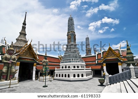 Wat Phra Kaew on a sunny day. Wat Phra Kaew is regarded as the most sacred Buddhist temple in Thailand, and is one of the most visited tourist attraction in the world.