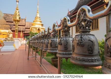 Wat Phra Singh (Wat Phra Singh Woramahawihan) temple, Chiang Mai, Thailand, February 1st 2021 : row or line of buddhist bells