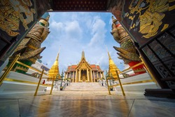 Wat Pra Kaew in Grand Palace Temple of the Emerald Buddha official name Wat Phra Si Rattana Satsadaram the landmark and famous place is travel destination in Bangkok,Thailand. Touring journey concept.