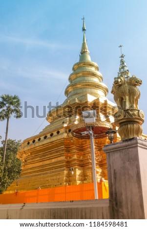 Wat Pra That Sri Jom Thong temple , pagoda , Golden pagoda in Wat Phra That Sri Chom Thong, the landmark Thai temple in Chiangmai province, north of Thailand / Golden pagoda in Wat Phra That Sri Chom  #1184598481