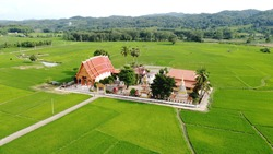 Wat Yu is a temple surrounded by green rice fields. Unseen temple in Nan Province, Thailand.