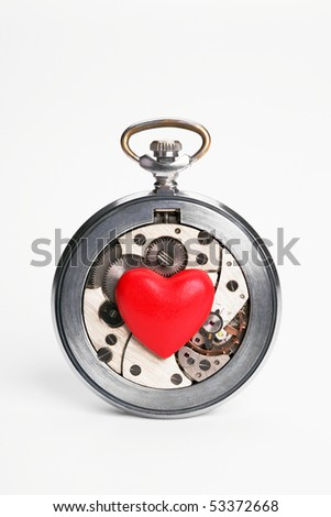 Watch and heart on a white background