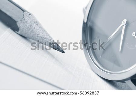 watch and pencil closeup
