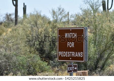 Watch For Pedestrians Advisory Sign
