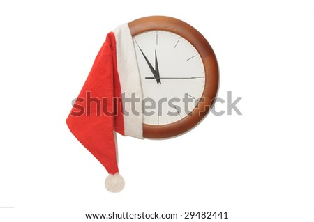 Watch in the hat of Santa Claus at the white background