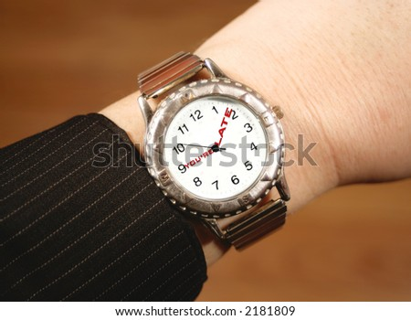 watch tells businessperson that they\'re late for work