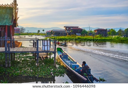 Watch the sunset from the stilt porch of old monastery on Inle Lake, Ywama, Myanmar. #1096446098
