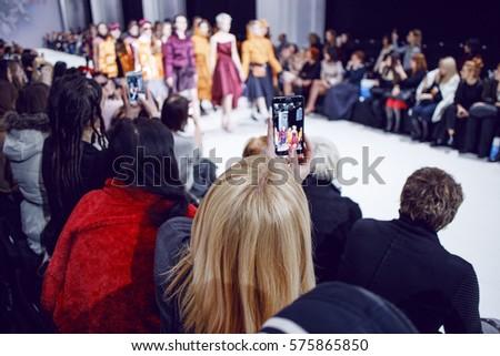 Watchers making photos on fashion show #575865850