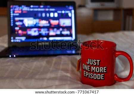 Watching series with a cup of tea. Just one more episode.