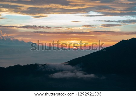 Watching sunrise from above the clouds and mist at mount batur in Indonesia. View to live for, amazing world amazing beauty #1292921593
