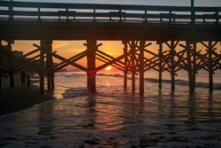 Watching sunrise through the ocean pier