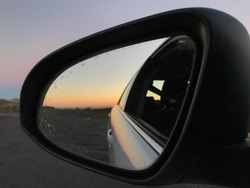 Watching sunset through car's mirror! Different views of sunset.