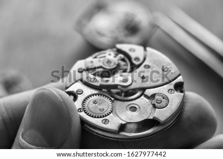 Watchmaker is repairing the wristwatch, mechanical watch
