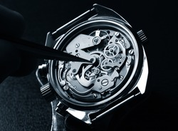 watchmaker working on watch close up detail