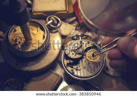 Watchmakers Craftmanship. A watch maker repairing a vintage automatic watch.